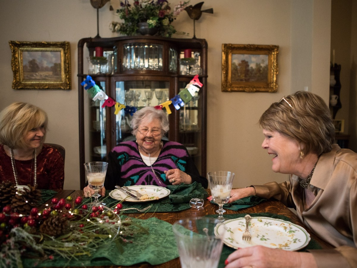 (From left) Sharon Mullen, Holocaust survivor Rose Williams, and Becky Hoag share a laugh at Mullen's birthday lunch.