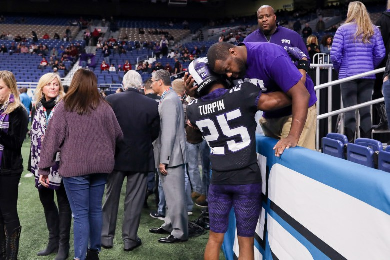 TCU wide receiver KaVontae Turpin embraces with a loved one just before the game begins.