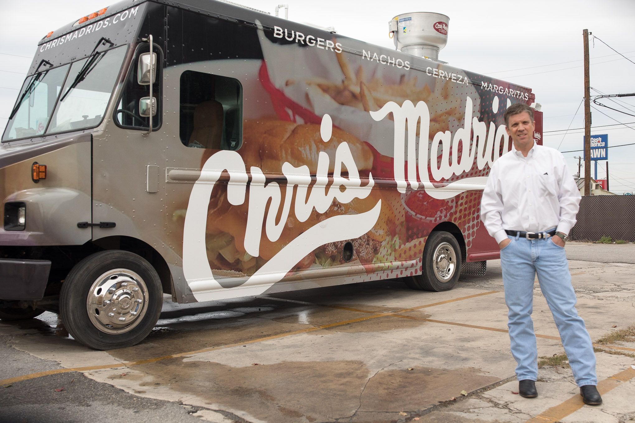 Richard Peacock stands in front of Chris Madrid's brand new food truck.