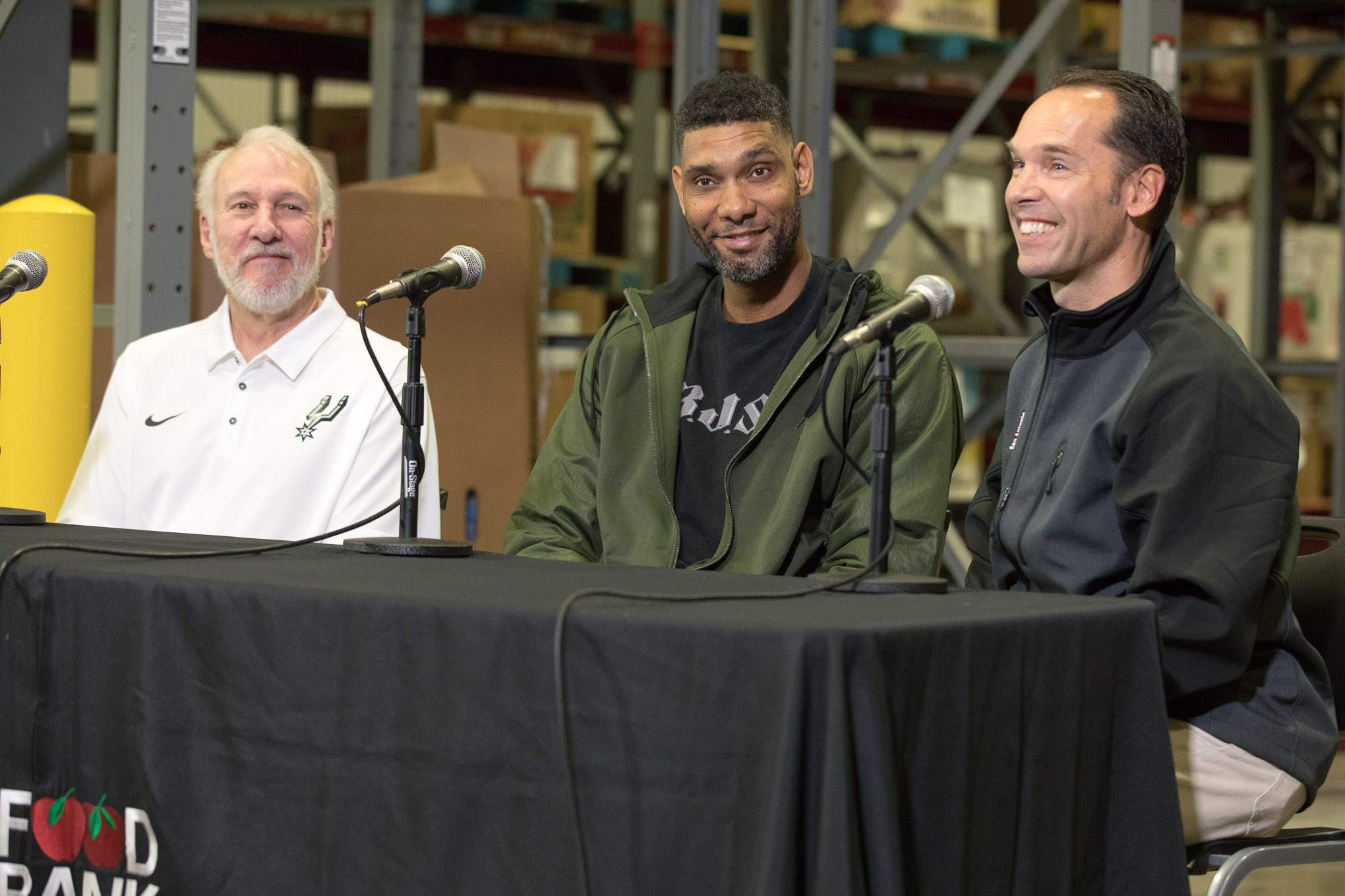 (from left) Spurs Head Coach Gregg Popovich, Retired Spurs player Tim Duncan, and Food Bank President and CEO Eric Cooper during the press announcement of the 'Tim Duncan '2:1' Holiday Challenge.