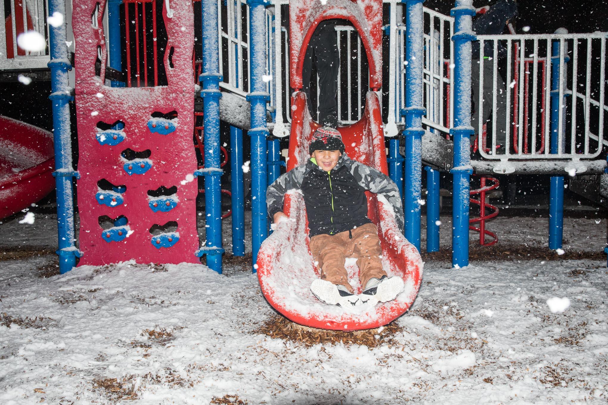 Johnny Alvarez, 10, slides at Pittman-Sullivan Park in the Denver Heights neighborhood.
