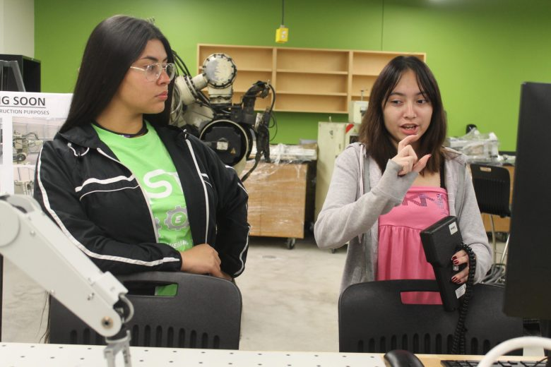 Ariana Fiel, 18, (right) a senior on the Southwest Engineering Team runs a robotics demonstration with her teammate, sophomore Laura Davis, 15.