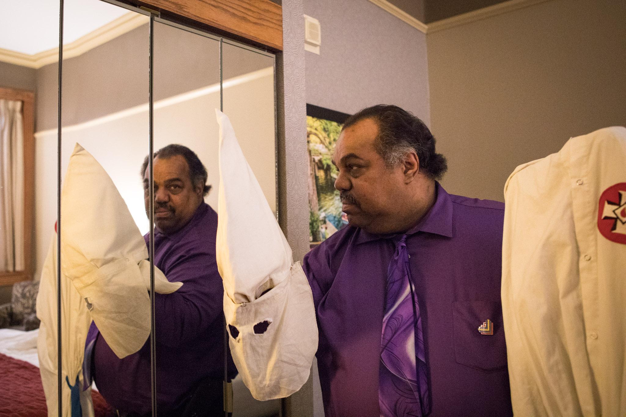 Daryl Davis holds a Ku Klux Klan hood given to him by a previous Klan member.