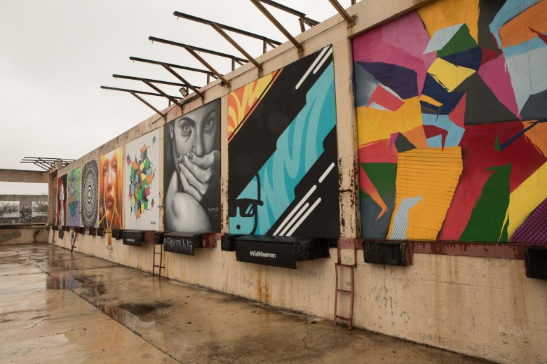 Murals adorn the side of the future Essex Modern City.