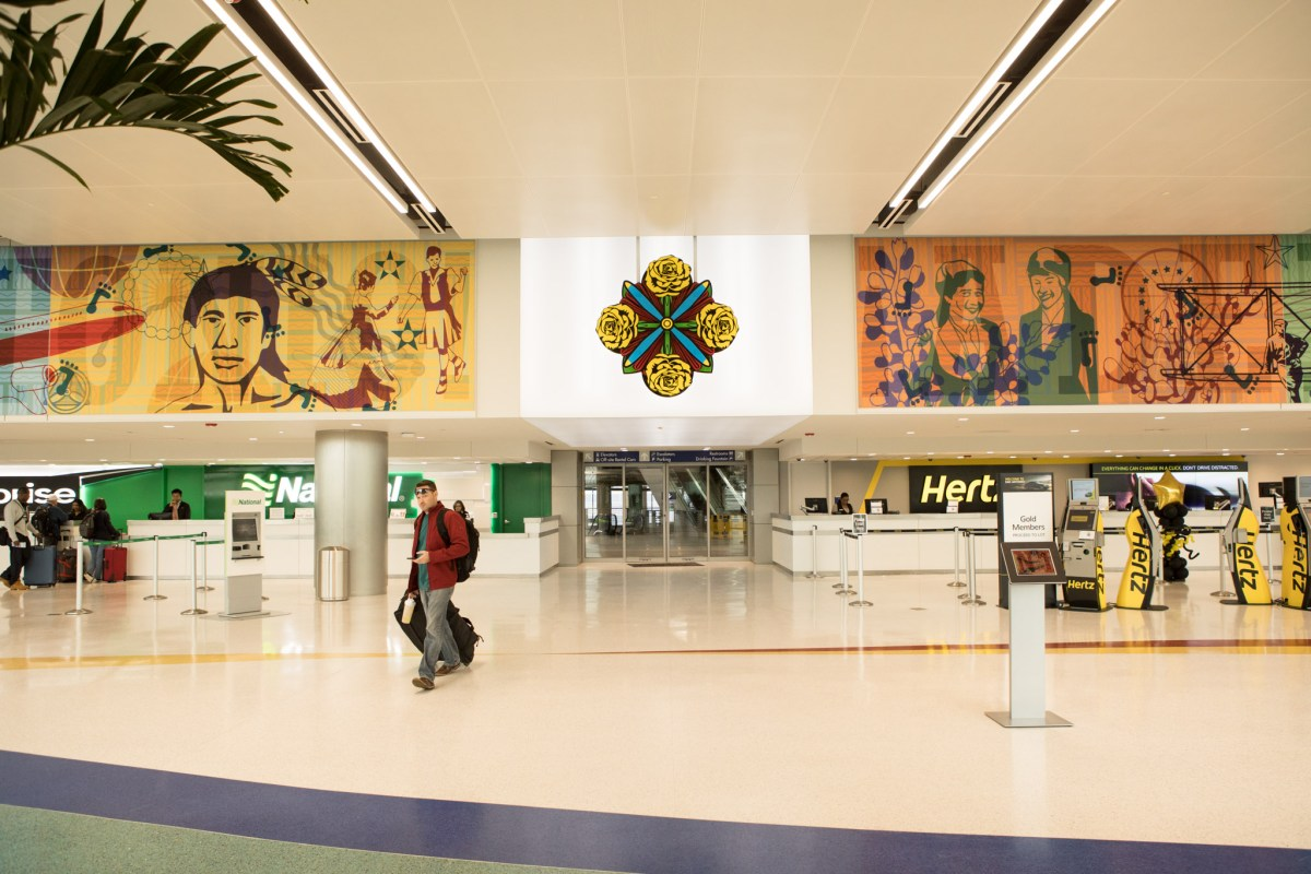 A 240-linear-foot, multi-panel mural adorns the walls of the new rental car facility at the San Antonio International Airport.