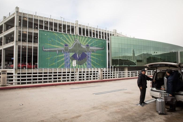 ¡Adelante San Antonio!, a three-part mural by local artist duo Dos Mestizx, greets passenger traffic outside of the San Antonio International Airport.