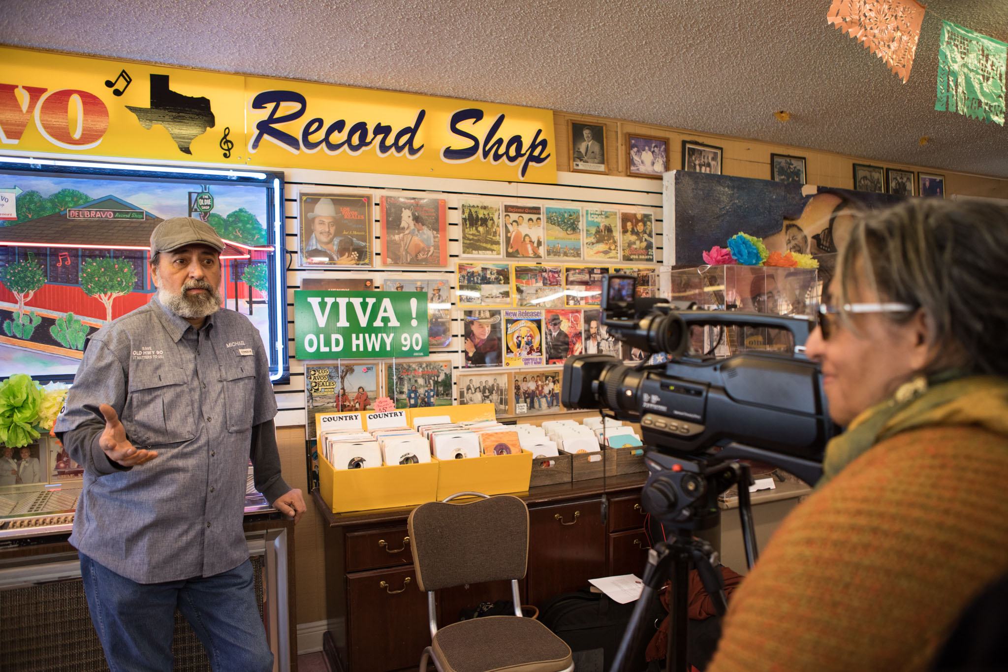 Michael Coormans (left), 4M Auto Supply owner, tells his experience owning a shop along Enrique M. Barrera Parkway, formerly known as Old Highway 90, to Claudia Guerra, Office of Historic Preservation Cultural Historian.
