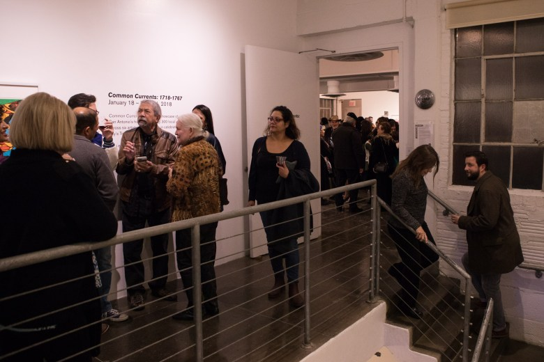 A large crowd is drawn to the Common Currents show at Artpace.