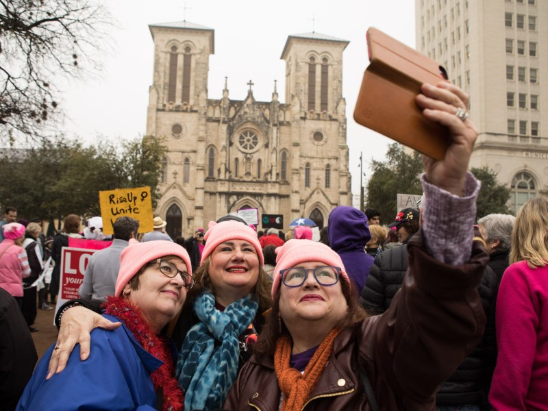 (From left) Becky McMillan, Joyce Champion, and Torchie Champion take a selfie in front of San Fernando Cathedral at the San Antonio Women's Rally.