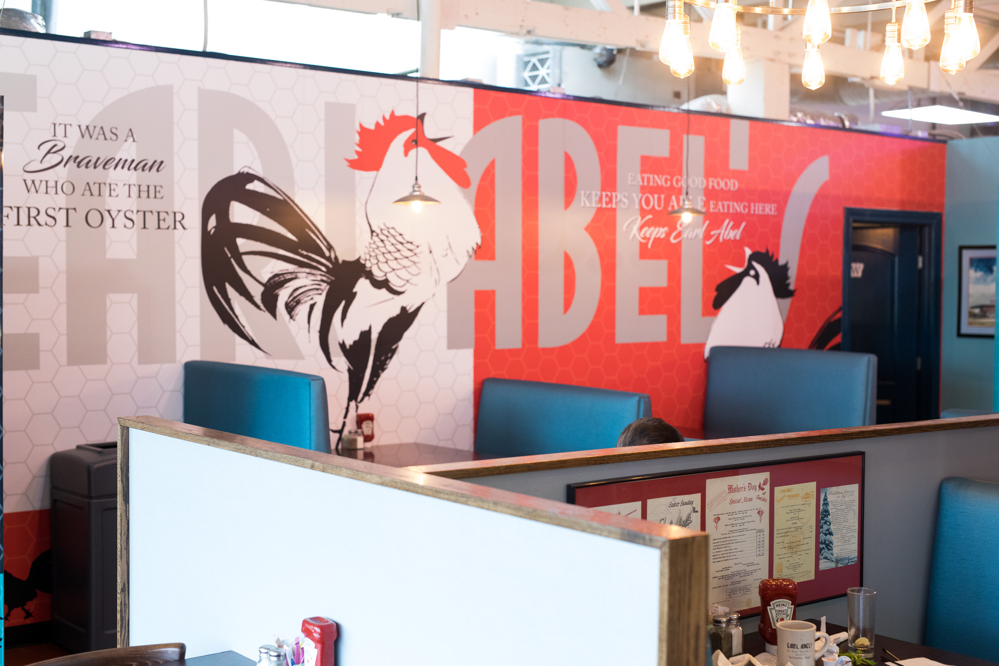 Large murals pay tribute to the future and past of Earl Abel's.