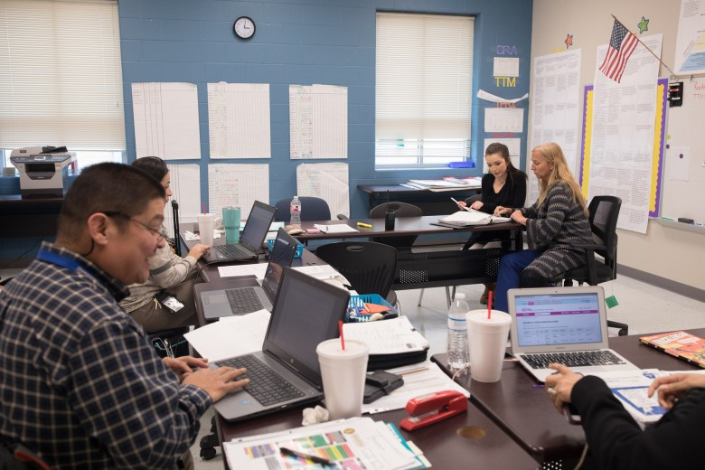 Principal Traci Smith works with teacher Brianna Villasenor on data sets on individual student performance.