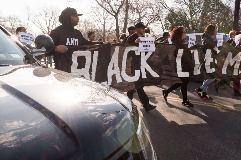 Black Lives Matter activists walk ahead of the official march in protest.