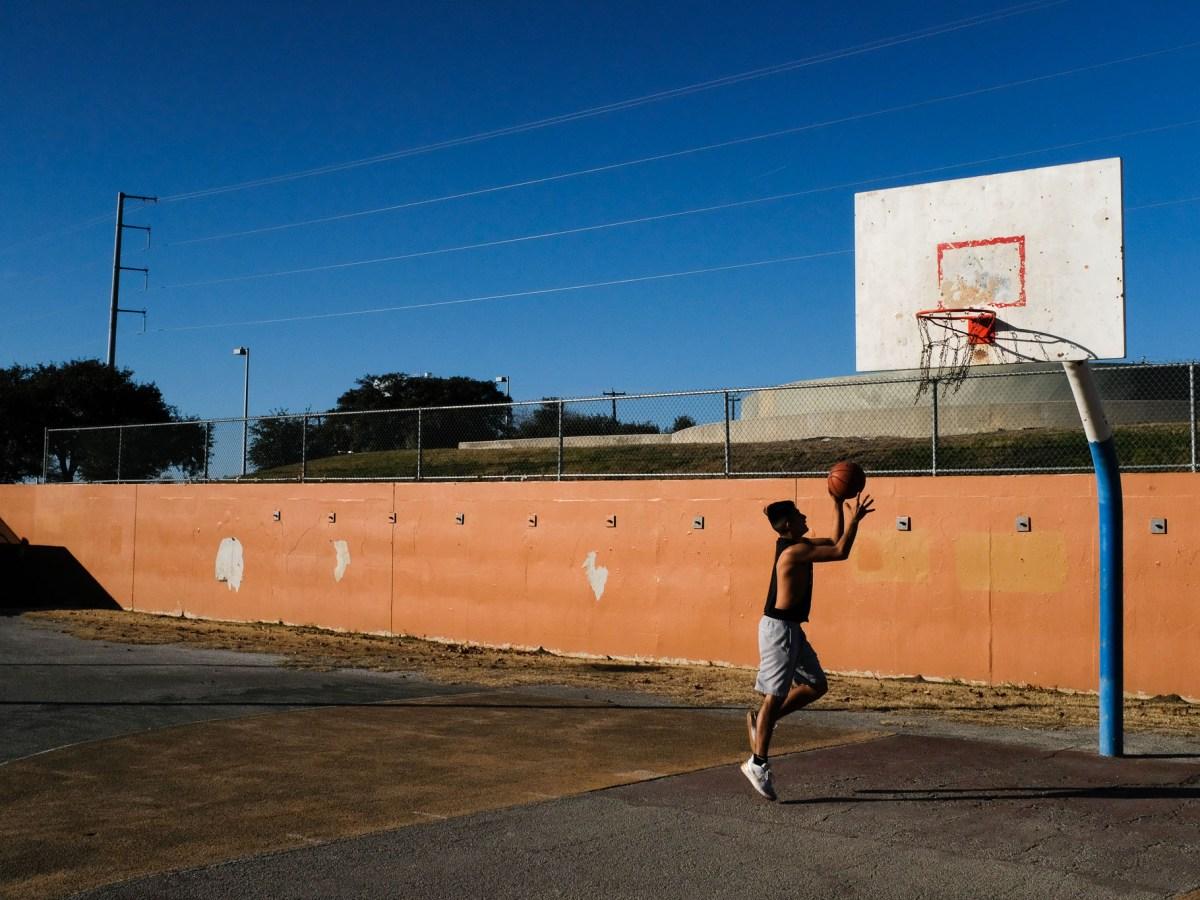 Devon, 17, plays basketball at Rosedale Park in the city's Westside. The park borders the Colonia San Ignacio neighborhood.