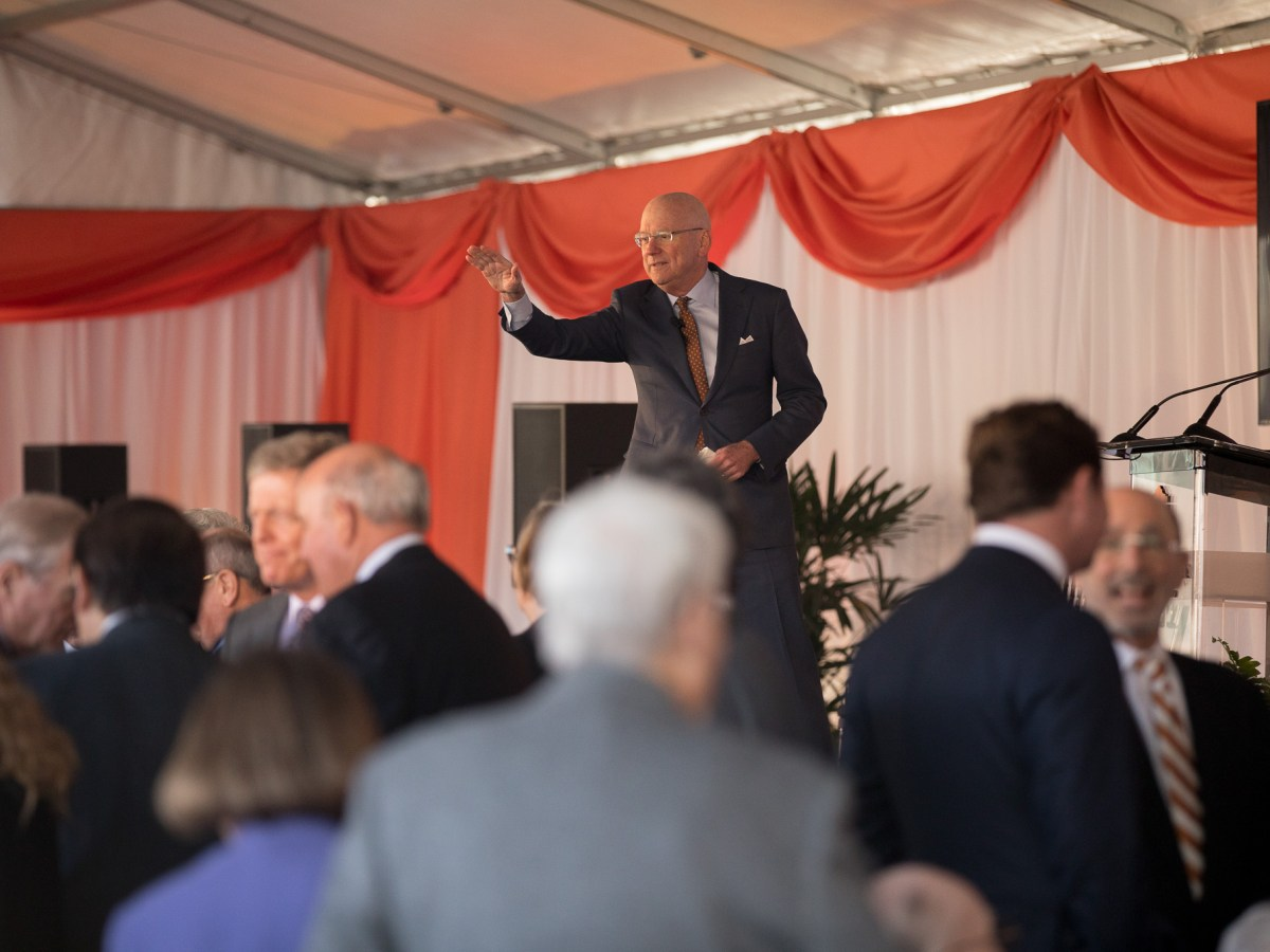 William Henrich waves to a member of the audience.