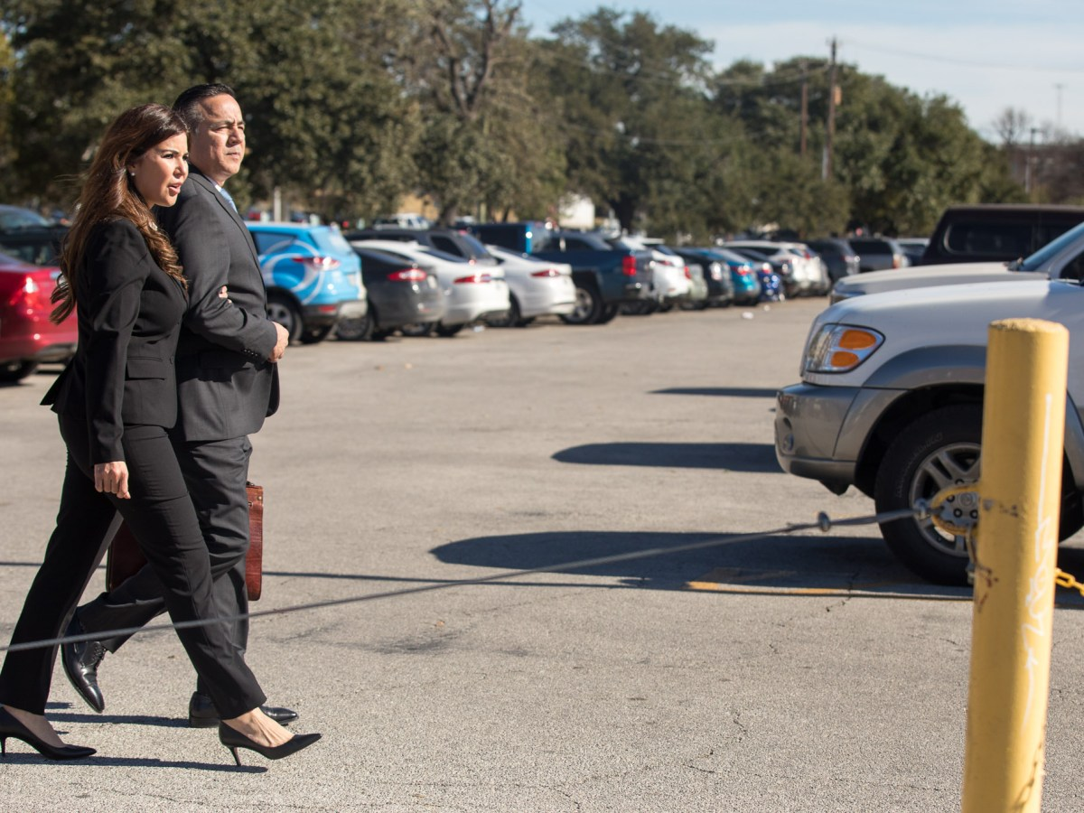 State Senator Carlos Uresti walks with his wife Lleana following an appearance in Federal Court.