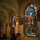 Stained glass lines the walls of Immaculate Heart of Mary Catholic Church.