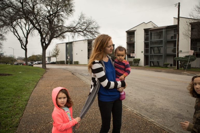 Maureen Galindo and her children (from left) Katie, 5, Brigid, 1, and AJ, 7, spend time at Columbus Park next to her Towne Center apartment, where she has lived since August 2017.