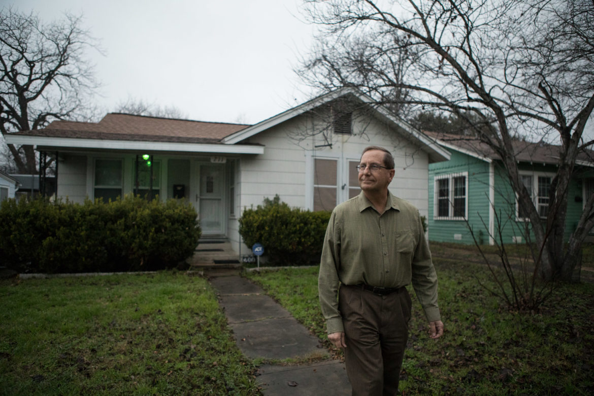 Gregory Ripps walks in front of his home in Highland Park.