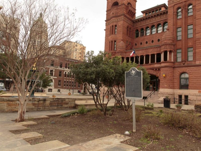 A Texas historical marker depicts the settlement and organization of Canary Islanders in 1731 stands outside the Bexar County Courthouse.