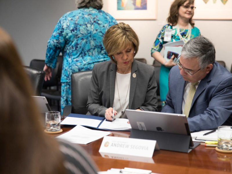 City Manager Sheryl Sculley and City Attorney Andy Segovia review notes during the Governance Committee meeting.