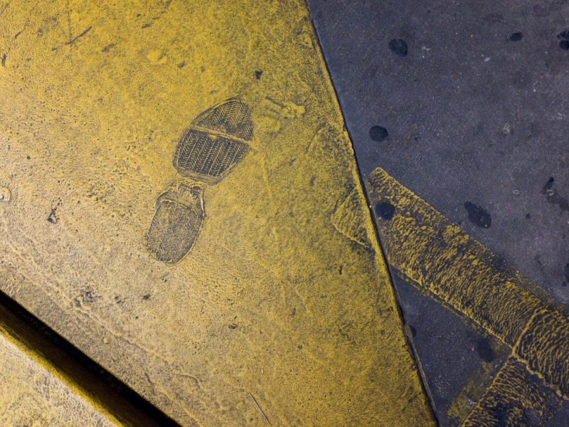 A footprint in a downtown parking garage off of Houston Street.