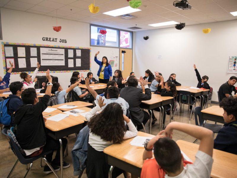 Students of the Mexican American Studies class at KIPP: Camino raise their hands when teacher Lucero Saldaña asks a question regarding Mexican identity.