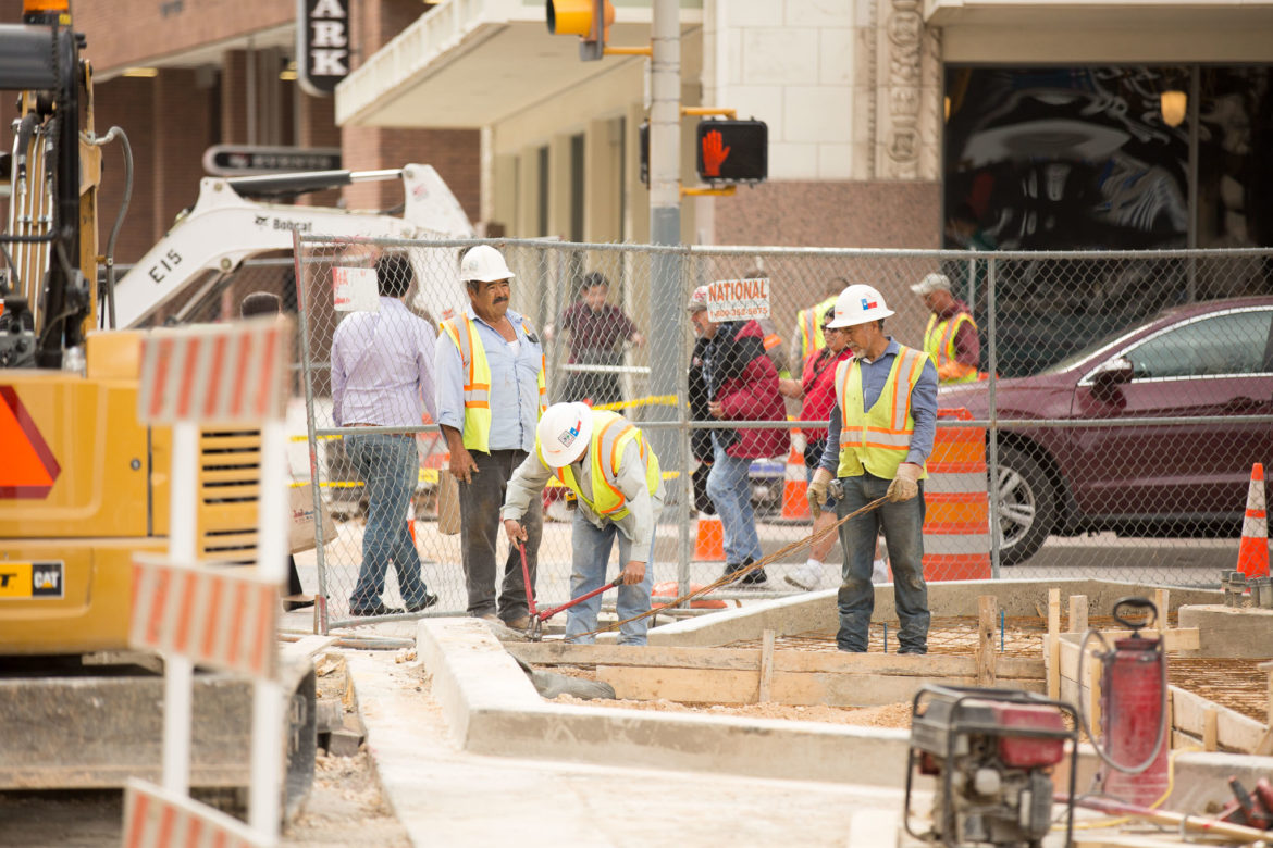 Crews work on a downtown sidewalk project at the corner of East Houston and Soledad.