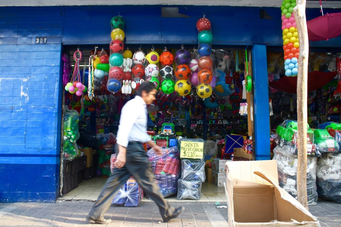A man walks outside a toy store in Guadalajara, Mexico.