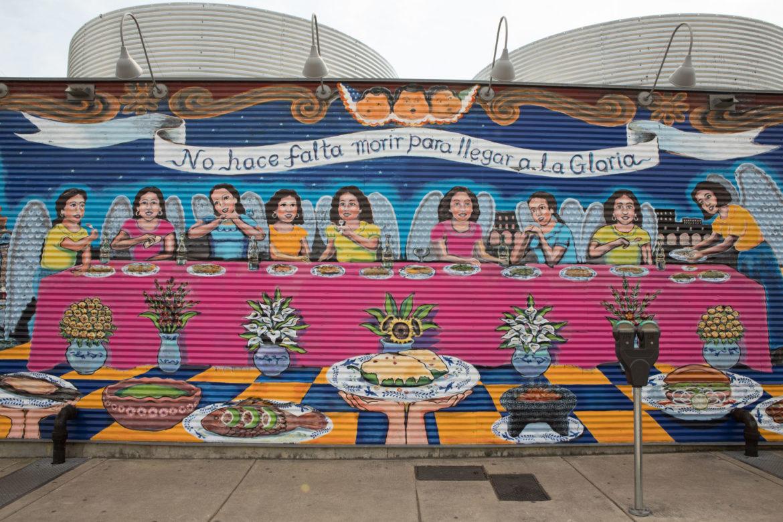 Claudio Aguillon's mural covers the facade of La Gloria facing Greyson Street.