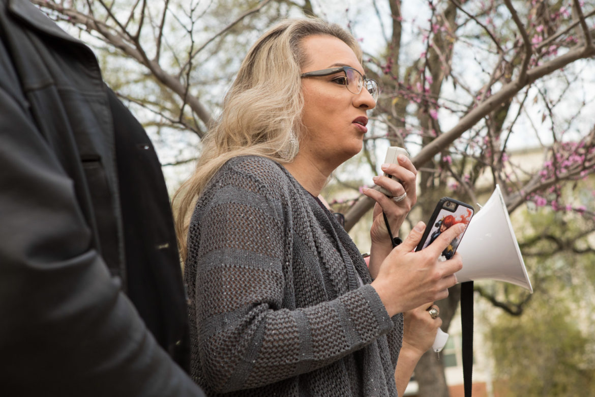 Frankie Gonzales-Wolfe speaks at a rally at Crockett Park to protest a ruling made in the case of Kenne McFadden.