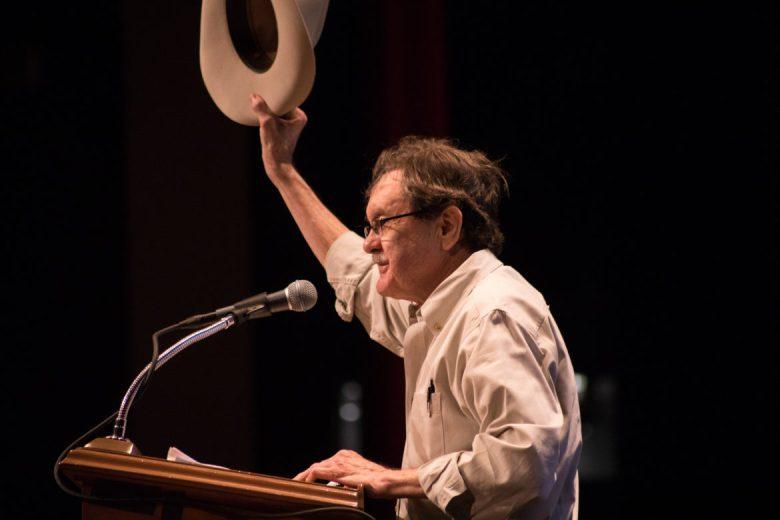 Jim Hightower speaks to a filled auditorium at Trinity University.