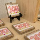 The Tricentennial merchandise shop at Centro de Artes offers a variety of products, including coasters.