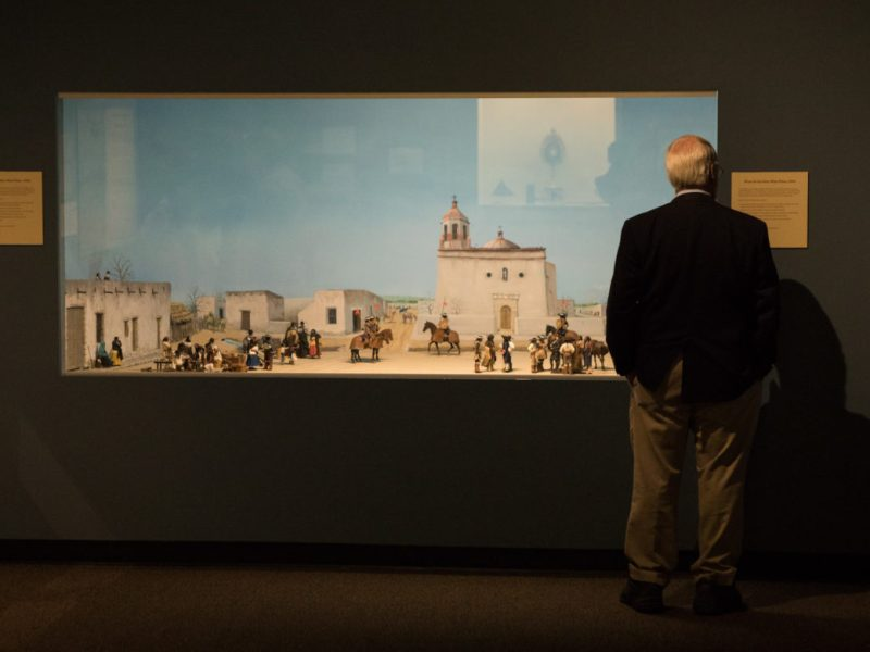 A museum visitor views the display of Plaza de las Islas at the Confluence and Culture: 300 Years of San Antonio History exhibit at the Witte Museum.