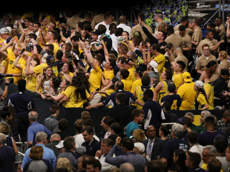 Michigan fans cheer after winning the game against Loyola.