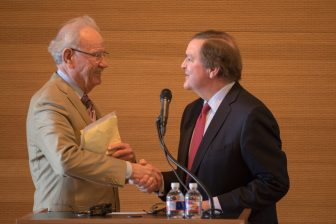 Former mayor Phil Hardberger shakes hands with Tobin Endowment Chairman Bruce Bugg Jr. after announcing the success of a ten million dollar fundraising goal for the now named Robert L.B. Tobin Land Bridge.