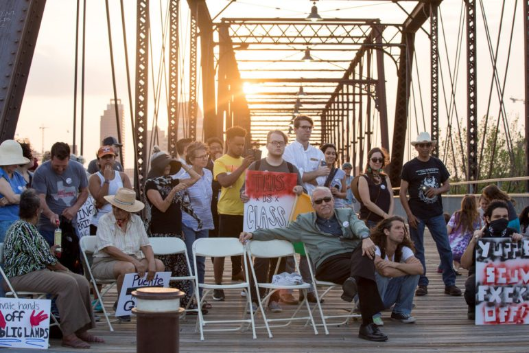 About 40 people attend a vigil at the Hays Bridge.