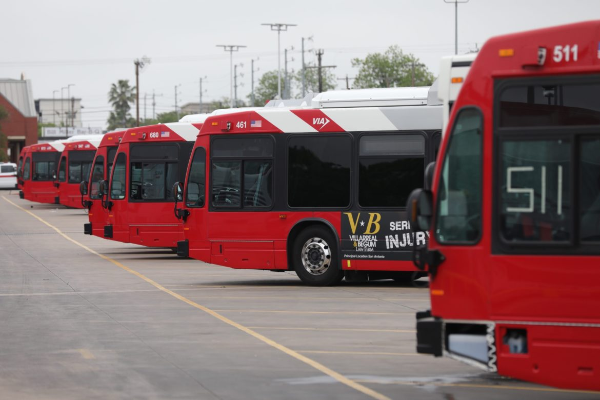 VIA buses lined in parking spaces at the refueling center.