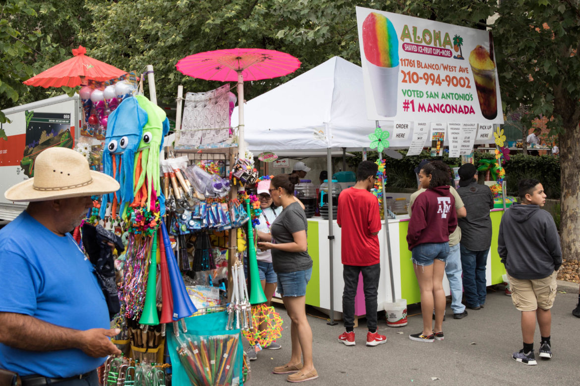Vendors line up along 12th Street to sell food and Fiesta gear to parade-goers.
