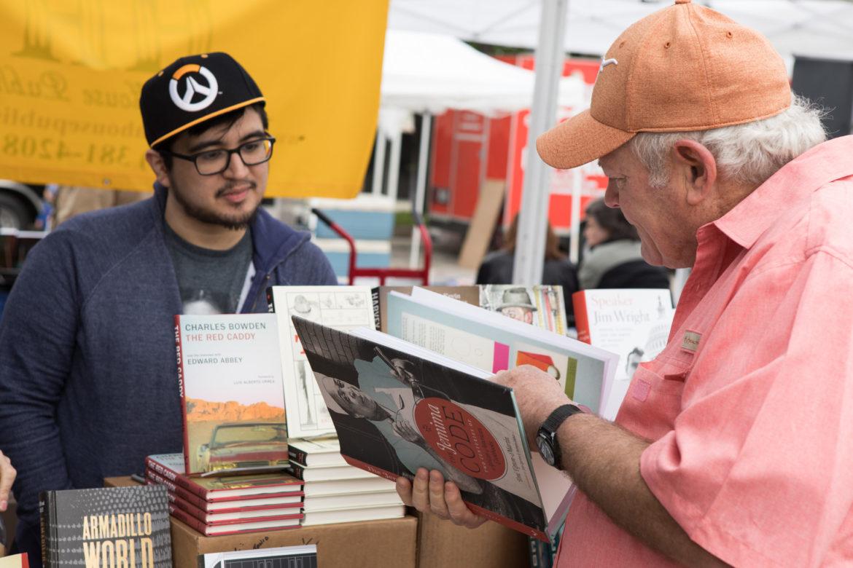 David Juarez, University of Texas Press fellow, sells books at the 6th annual San Antonio Book Festival.