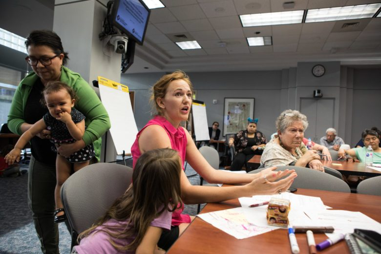 Maureen Galindo partakes in a community work session discussion of the new short term rental assistance program funded by the Community Development Block Grant.