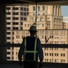 Weston Urban CEO Randy Smith looks at the Milam Building from the 11th floor of Frost Tower, which is under construction.