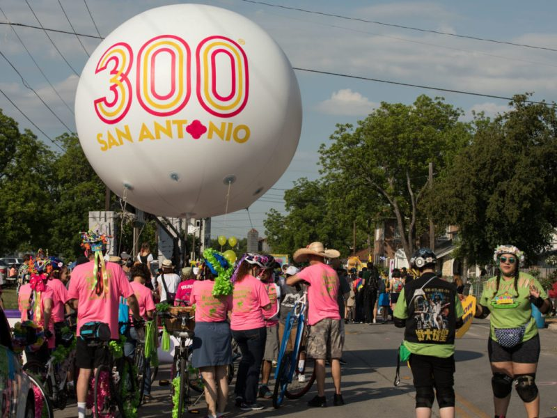 The Tricentennial float towers over the parade before it begins.