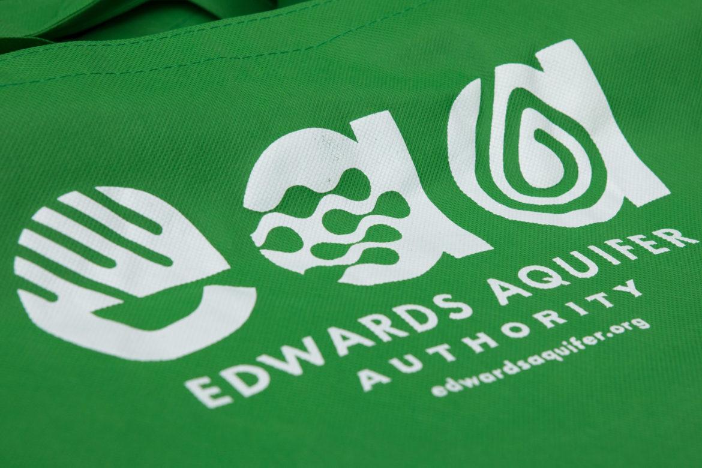 Edwards Aquifer Authority logo on a tote bag.