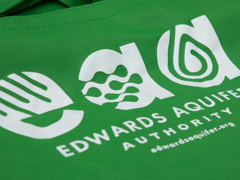 Edwards Aquifer Authority logo on a tote bag.