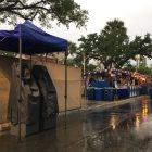 Rain-covered ATMs await crowds as NIOSA's Wednesday night opening was delayed until 6:45 due to bad weather.