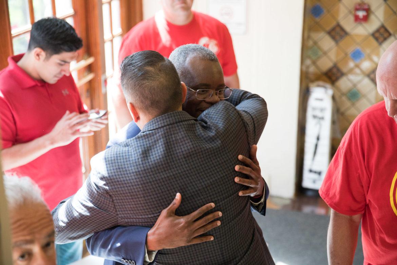 Councilman Greg Brockhouse (D6) embraces with San Antonio Professional Firefighters Association President Chris Steele.