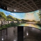 Abraham Vasquez's paintings are displayed uniquely on curved frames.