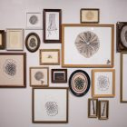 Gaby Borrego's work Family Trees is comprised of etchings, collagraphs, collagraph plates, and found frames.