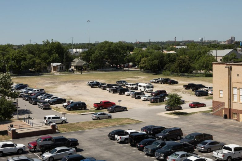 The proposed Convocation Center would be built in this lot next to Central Catholic High School.