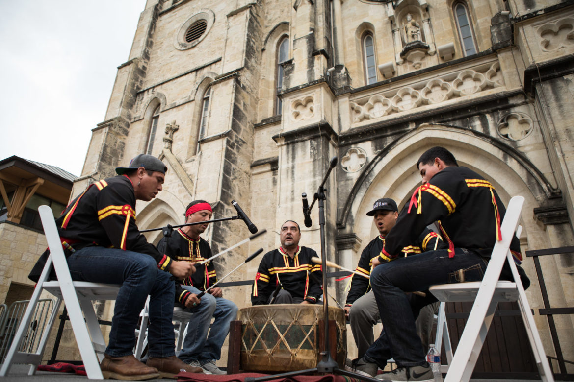 Native American drummers perform before the interfaith reflections are given on stage.